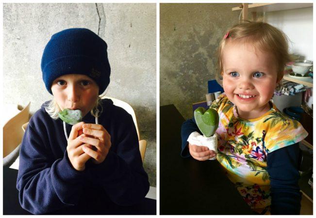 Cute kids eating healthy popsicles